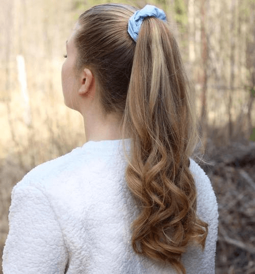curly ponytail with scrunchie