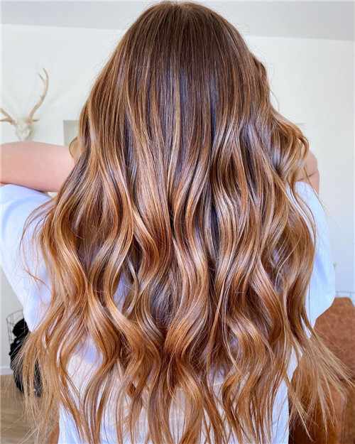 strawberry blonde balayage on brown hair
